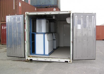 Dual ice machines installed in a shipping container with doors at either end for ease of access