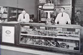 Historic photo of butcher shop display cabinets
