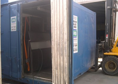 2 ice machines installed inside a refrigerated shipping container which allows for storage of excess ice
