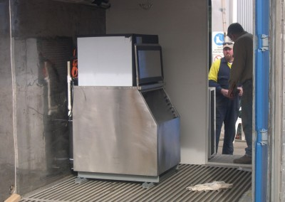 Ice machine plumbed and electrically wired into a 10 foot refrigerated container