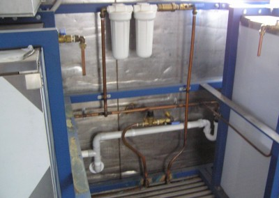 Plumbing-for-ice-machines-including-water-filters-installed-in-a-refrigerated-shipping-container