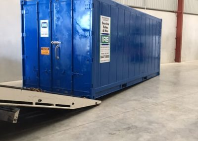 Refrigerated shipping container recently  resprayed blue.