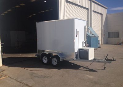 A coolroom mounted on a trailer showing the operating equipment
