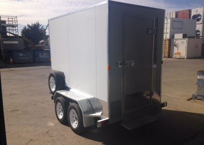 A mobile coolroom mounted on a trailer with a spare tyre built for coolroom hire company