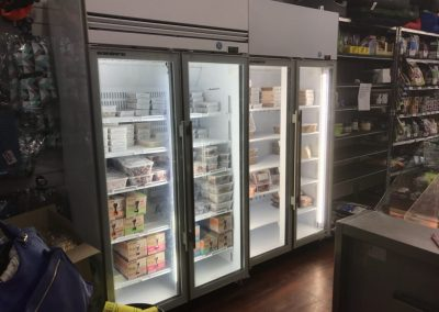 A two door commercial display fridge and a A two door commercial display freezer used in Scruffies Glenelg retail store