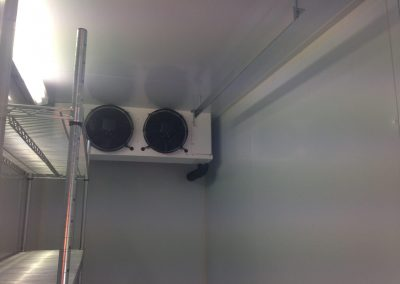 The inside of a new transportable coolroom showing shelving system